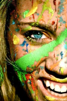 spattered of paint colours in the face