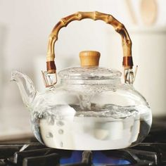 "Buddha Belly Tea Kettle | The round belly of our bamboo-handled glass teapot elicits smiles, as does the pure-tasting tea it's smartly designed to brew. Stovetop-safe, at medium heat or below. Hand wash. 6""DIAM x 5""H, HOLDS 36 OZ. 
