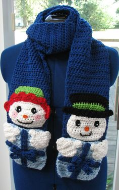 This listing is for the crochet pattern to make this holiday scarf of a boy and girl snowman. This scarf features pockets that look like gifts. The scarf was made using Red Heart yarns and size H hook. All the pieces are made and then layered together to give its detailed look. Finished size: 6 X 68  This is a pattern of my own design. Author holds all rights. Any item you make from one of my patterns you may sell. You can not sell or give the pattern away.  Etsy will e-mail you a link to…