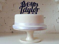 Mr & Mrs...' Personalised Cake Topper - The Little Bird Design. £22.99, via Etsy.