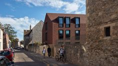 Handmade clay tiles cover this gabled accommodation building added to a boarding school in the English city of Canterbury by London firm Walters & Cohen.