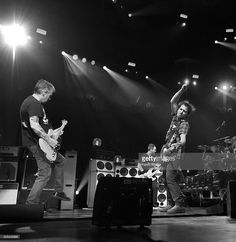 Image converted to black and white) Mike McCready and Eddie Vedder of Pearl Jam perform at Wells Fargo Center on April 29, 2016 in Philadelphia, Pennsylvania.