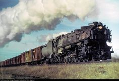 The Steam Channel..........................A 4-12-2 speeds by with stock cars in tow. Photo by Collection of Chris Zygmunt