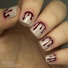 This bloody nail art by is a scary but chic design to celebrate Halloween. #halloween #nails