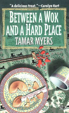 Between a Wok and a Hard Place (Pennsylvania Dutch Mystery #5)  by Tamar Myers. Click on the green Libraries button to find this in a library near you!