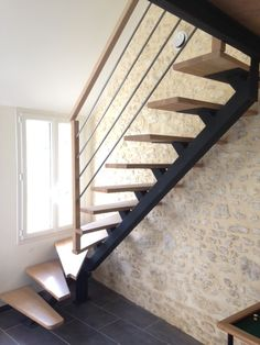 Metal and wood staircase. Custom-made staircase with central metal stringer and beech steps, .