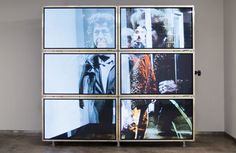 Stacked up like HDB units | photo of a video installation in a gallery consisting of six video screens