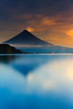 Mayon Volcano has a dramatically perfect cone shape that stands out in the landscape outside of Legazpi City, Albay.