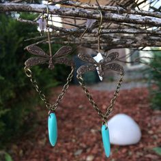 Super pretty little earrings, handmade by me. These are some of my favorites! These dainty little earrings have a gorgeously detailed dragonfly charm, with a small chain dangling from it, and a turquoise colored dagger bead! These are a tiny bit over 2 in length, and hang from a lever
