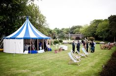 Traditional English garden wedding with tent and deck chairs