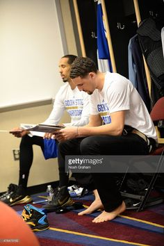 Klay Thompson #11 of the Golden State Warriors reads a newspaper in the locker room before a game against the Cleveland Cavaliers in Game Three of the 2015 NBA Finals on June 9, 2015 at The Quicken Loans Arena in Cleveland, OH.