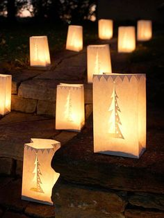 Outdoor Holiday Luminarias ...  Turn paper bags into dramatic luminarias by cutting out your own designs with a crafts knife, hole punchers, and scissors. Then wait for dusk, fill the bottom with sand, and drop in a tea light to bring your walkways to life. (Use battery-powered votives if you're not going to be at home while these are on display.)
