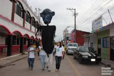 Let's celebrate the International Black Howler Monkey Week: A giant howler monkey parade puppet roamed the streets of Balancan. The marching band followed behind. One person (center) held the pole and two people helped twist and turn the pole to get the monkey to dance. — in Tabasco, Mexico. By Primate Education Network