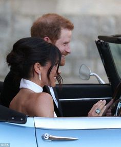 Meghan could be seen wearing an aquamarine ring which once belonged to Harry's mother, Princess Diana (right)