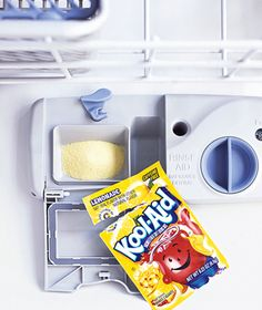 Clean lime deposits and iron stains inside the dishwasher by pouring a packet of lemonade Kool-Aid (the only flavor that works) into the detergent cup and running the (empty) dishwasher. The citric acid in the mix wipes out stains; you don't have to.