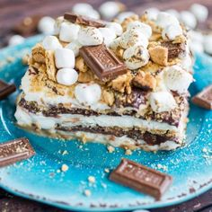 S'mores Icebox Cake - An over-the-top s'mores icebox cake complete with marshmallow whipped cream, soft chocolate ganache, graham crackers and toasted marshmallows!