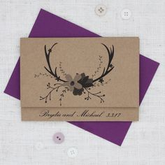 These rustic invites feature a set of deer antlers and a feminine touch of flowers. The  wedding invite is posted to guests closed, and allows the guests to anticipate what this exciting parcel could be, while opening up the front flap to reveal the main wedding invitation inside. The deer antlers are black and are positioned with the bouquet of flowers in black and grey tones.  This invitation is printed onto recycled look kraft card gives a rustic look which lends itself to the hunting…