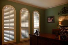 Plantation shutters are always a great idea for windows with a shapes.     Curtain Call Creations we will bring to you a huge array of materials and finishes to create your custom wood or synthetic shutters.     We guarantee a perfect fit!