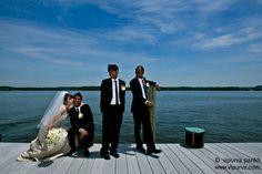At Adele and Karl's wedding. Adele kisses Karl as Kelvin and Kristofer, the groomsmen look on.