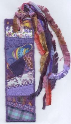 Purple crazy quilted bookmark. $10.00, via Etsy.