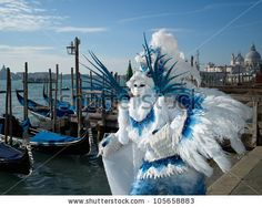 VENICE - FEBRUARY 17, 2011: Person in Venetian costume attends the Carnival of Venice, festival starting two weeks before Ash Wednesday, on February 17, 2011 in Venice, Italy. - stock photo