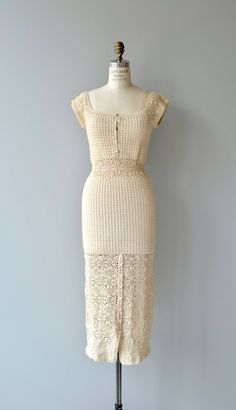 Vintage 1970s exceptionally well-made cream cotton crochet dress with squared neckline, cap sleeves, button bodice, wide crochet waist and partial button front skirt. --- M E A S U R E M E N T S --- fits like: xs/small bust: 32-34 waist: 26-30 hip: up to 38 length: 50 brand/maker: n/a condition: excellent to ensure a good fit, please read the sizing guide: http://www.etsy.com/shop/DearGolden/policy ✩ layaway is available for this item ✩ more vintage...