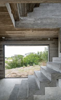 Architect Luciano Kruk designs a house made of three stacked forms of rough unfinished concrete overlooking a golf course in Argentina Minimalist Architecture, Space Architecture, Futuristic Architecture, Concrete Interiors, Beton Design, D House, House Studio, House Stairs, Concrete Houses