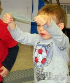 """Snowflake games + piggy back song using net 'tulle' circles for snow. Book buddy with """"The Snowy Day"""""""