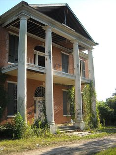Arlington an abandoned mansion in Natchez, Mississippi. It is sad that someone just had to put graffiti all over this once beautiful home.