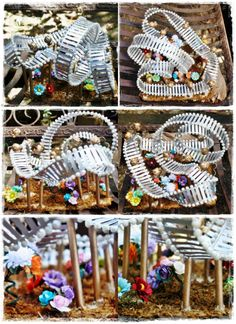 My miniature roller coaster made from paper die cuts (picket fences), wooden sticks, silver enamel, dried moss and paper flowers. Base is a chipped plate I saved.