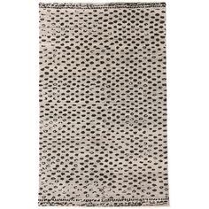 Get a little dotty with this hand-knotted wool area rug, featuring black leopardlike spots on a pale grey background. The goes-with-anything color combo and superthick and plush feel make this rug perfect for bedrooms and family spaces. BENEFITS: Durable construction; plush, high profile; eye-catching, unusual weave. Because the weave lies in a single direction and is not apt to pull, hand-knotted rugs can appear lighter from one angle than the other