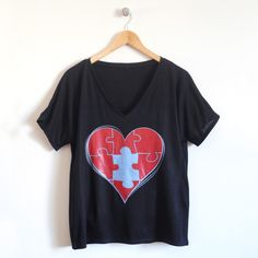 Piece of My Heart Ladies T-Shirt in Black –   Perfect for the mom who constantly gives of her heart to those around her. And for all of those littles that make her heart complete, check out our coordinating puzzled tee.  Available in 3 fit options on cloudandclover.com: fitted crew, fitted v-neck and loose v-neck.