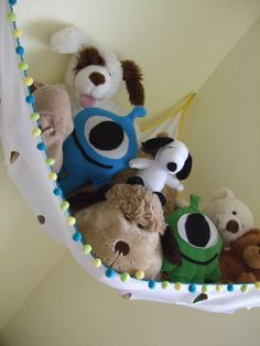 stuffed animal net...Love this one! So simple! You could even just hang a rope from a plant hanger on the ceiling, and then clip the stuffed animals right to the rope with clothespins! Great way to utilize the higher spaces in the room. But be prepared to be called in to help the little guys get the treasures they can't reach!