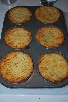 Just mash potatoes plain with butter or you can add yummy ingredients like cooked bacon, cheese, parsley, green onion, garlic, etc. Stuff in to a greased muffin tin, run a fork along the top and brush with melted butter or olive oil. Bake at 375 degrees or until tops are crispy and golden.