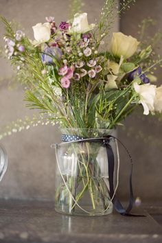 Rustic wildflower arrangement captured by Studio 33 Weddings