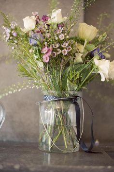 Rustic wildflower arrangement captured by Studio 33 Weddings