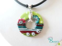 Like the little silver charm with the polymer clay disc.