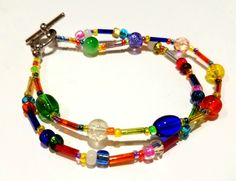 Multiple colored, multiple strand bracelet.  Approximately 6 and 3/4 inches. by B4Jjewelrydesigns on Etsy