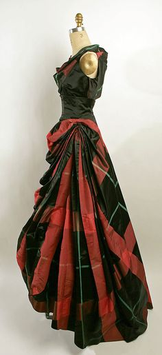 Evening dress - 1950 -- makes me think of a gothic Harley Quinn.