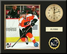 One 8 x 10 inch Philadelphia Flyers photo of Claude Giroux inserted in a gold slide-in frame and mounted on a 12 x 15 inch solid black finish plaque.  Also features a 3-inch Arabian gold-faced clock, a customizable nameplate* and a 2-inch hockey medallion with a gold base. $59.99  @ ArtandMore.com