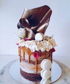 Stunning copper chocolate shard naked cake with caramel drip, macarons & toasted italian meringue