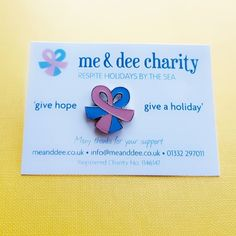 Lovely logo bow charity badge with attractive backing card - ML Charity Badges handle your complete fundraising requirements from initial discussions, quote & delivery. Goods are supplied ready to distribute to your fundraising team with the badge on the cards & in their individual polybags, simple, allied to guaranteed best price in UK. Talk to the rest, then come to the best.  @mlbadges