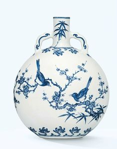 An extremely rare and important blue and white 'magpie and prunus' moon flask, Yongzheng six-character mark