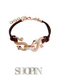 This Shopin bracelet features two snakesheld together by a central row of black zircons.  Pink plated bronze. Nickel free and hypo-allergenic. Made in Italy. Length: 17cm+4cm Strong and bold design to strike the eyes!
