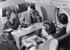 Lunch in first class on board a BEA Vickers Viscount, 1953. Flying was still a luxurious mode of transport, with space for congenial eating and seating arrangements; one could also enjoy an after-dinner smoke. //  Airline: Style at 30,000 Feet (mini edition). Courtesy of Laurence King Publishing. // http://www.yatzer.com/airline-style-at-30-000-feet