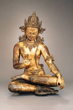 13th C. Seated Avalokiteshvara (bothisattva), Nepalese sculpture in gilt copper with semiprecious stone inlays.  Rockefeller 3rd Collection.