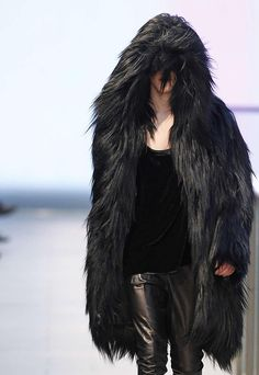Men's wear trend theme in 2014 F/W is artic expedition. - The black fur coat is casual and funky style. It looks so warm.