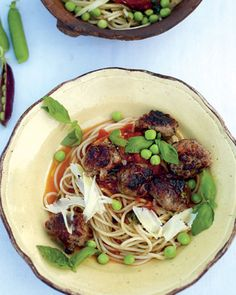 quick sausage meatballs with a tomato and basil sauce, spaghetti and sweet raw peas