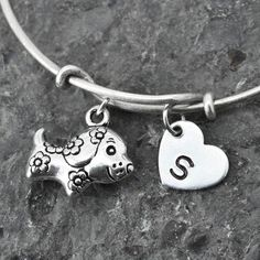 A personal favorite from my Etsy shop https://www.etsy.com/ca/listing/229924972/dog-charm-bangle-sterling-silver-bangle