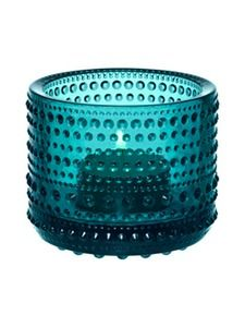 This design has spawned many copies but the quality of the iittala design and craftsmanship shines clearly in this glass votive . The Finnish name